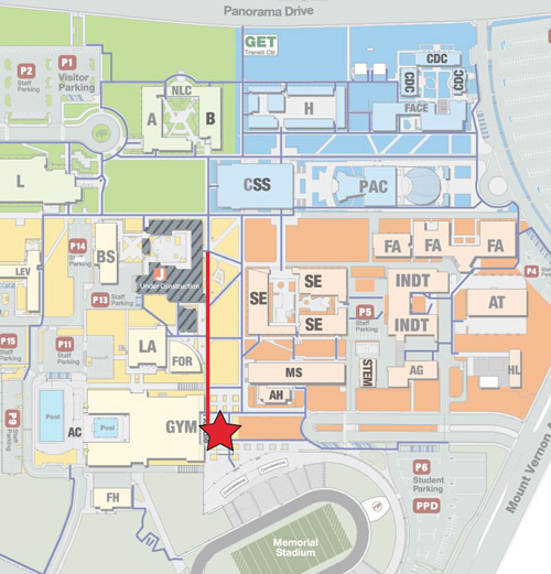 The Huddle is located south of the campus center by following the pathway.